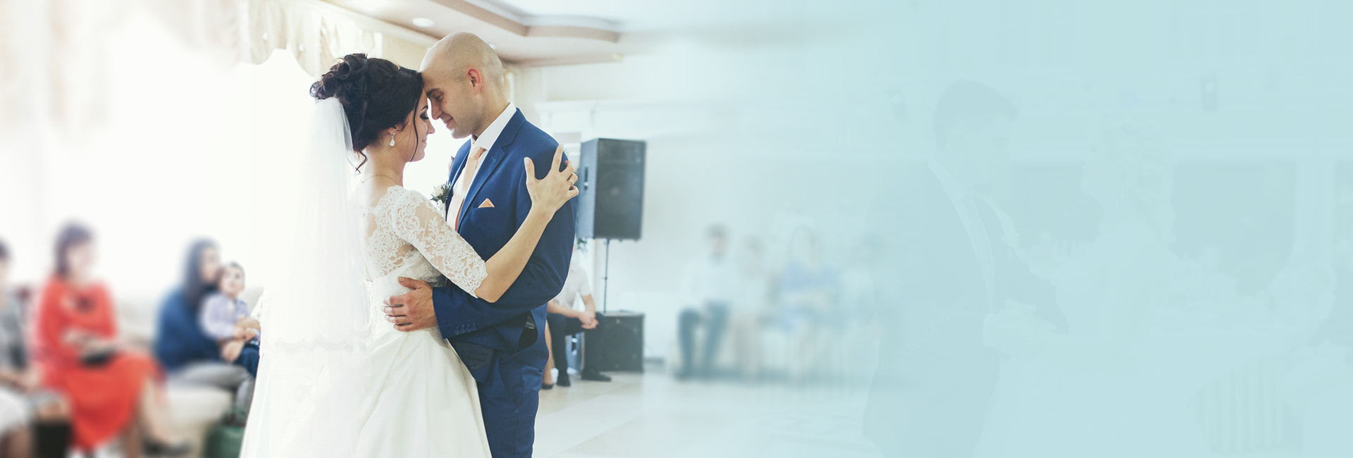 A couple dancing in front of a wedding band
